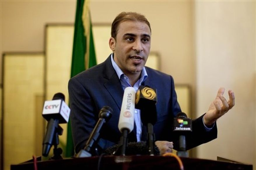 ** FILE ** In this Saturday, Aug. 13, 2011, file photo, Libya's government spokesman Moussa Ibrahim speaks to the press at a hotel in Tripoli, Libya. Ibrahim was captured as he was trying to flee Bani Walid, according to the Libyan State News Agency on Saturday, Oct. 20, 2012. (AP Photo/Dario Lopez-Mills, File)