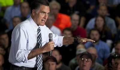 ** FILE ** In this Oct. 10, 2012, file photo, Republican presidential candidate, former Massachusetts Gov. Mitt Romney gestures during a town hall meeting at Ariel Corp. in Mt. Vernon, Ohio. (AP Photo/ Evan Vucci, File)