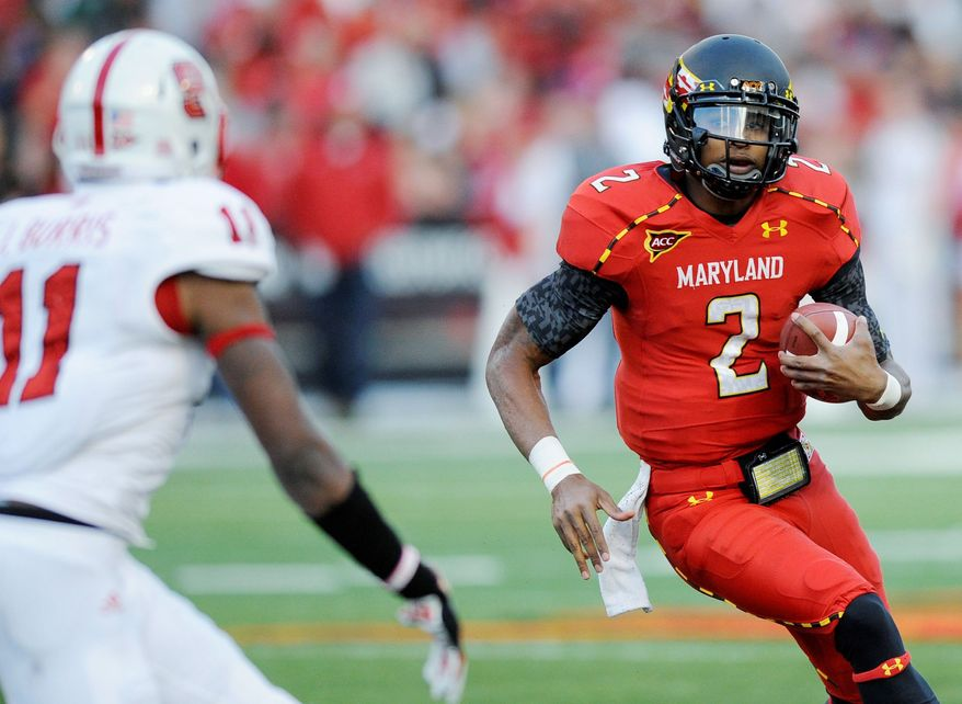 Maryland quarterback Devin Burns (2) runs with the ball against North Carolina State defensive back Juston Burris (11) during the second half of an NCAA college football game, Saturday, Oct. 20, 2012, in College Park, Md. North Carolina State won 20-18. (AP Photo/Nick Wass)
