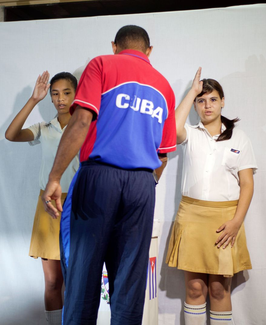 A man casts his ballot at a polling station in Havana on Sunday. Cubans cast ballots to choose among candidates for municipal assemblies that administer local governments and relay complaints on pressing issues, including housing. (Associated Press)