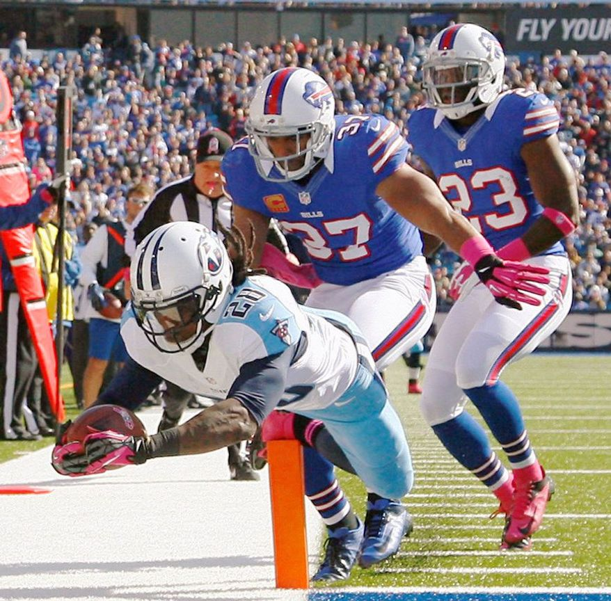 Titans running back Chris Johnson dives in for the first of his two touchdowns Sunday during the first half of Tennessee's win over the Bills in Orchard Park, N.Y. Johnson, who has struggled for much of the season, rushed for 195 yards on the day. (Associated Press)