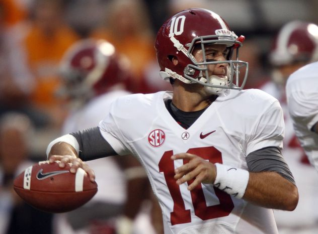 Alabama quarterback AJ McCarron (10) throws to a receiver before an NCAA college football game againstTennessee, Saturday, Oct. 20, 2012, in