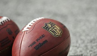 Footballs are on the field at MetLife Stadium before an NFL football game between the New York Giants and the Tampa Bay Buccaneers Sunday, Sept. 16, 2012, in East Rutherford, N.J. (AP Photo/Bill Kostroun)