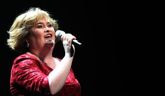 Susan Boyle performs during her show 'I Dreamed a Dream' at the Theatre Royal in Newcastle, England, on Tuesday, March 27, 2012. (AP Photo/Scott Heppell)