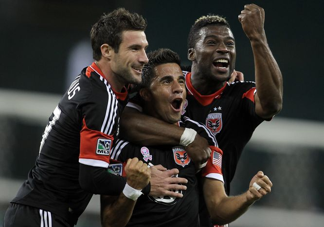 D.C. United has rallied around the loss of midfielder-forward Dwayne De Rosario, reeling off a 5-0-1 record capped off by their first playoff spot since 2007. Pictured from left to right: midfielder-forward Chris Pontius, midfielder Marcelo Saragosa and defender Brandon McDonald. (Tony Quinn/D.C. United)