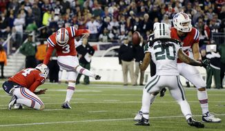 New England Patriots kicker Stephen Gostkowski (3) makes the winning field goal against the New York Jets in overtime of an NFL football game in Foxborough, Mass., Sunday, Oct. 21, 2012. Holding is punter Zoltan Mesko (14). The Patriots won 29-26. (AP Photo/Elise Amendola)