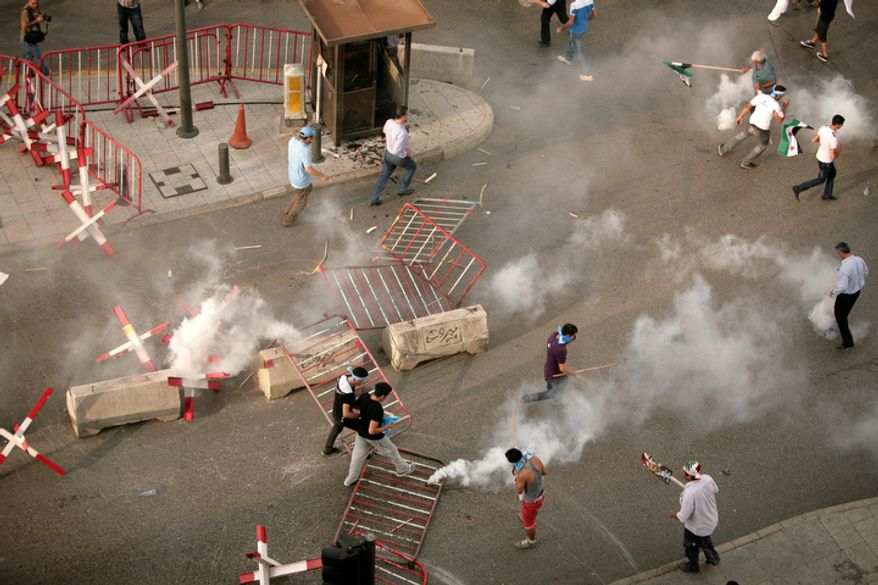 Police and protesters clash after the funeral of Brig. Gen. Wissam al-Hassan in Beirut, Lebanon, Sunday, Oct. 21, 2012. (AP Photo/Maya Alleruzzo)