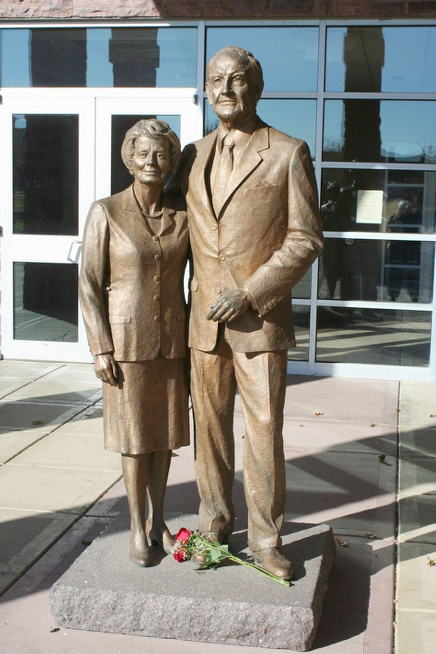 Two roses lie at the base of statues of George and Eleanor McGovern on Sunday, Oct. 21, 2012, outside the McGovern Library in Mitchell, S.D. A family spokesman says, McGovern, the Democrat who lost to President Richard Nixon in 1972 in a historic landslide, has died at the age of 90. According to the spokesman, McGovern died Sunday, Oct. 21, 2012 at a hospice in Sioux Falls, surrounded by family and friends. (AP Photo/The Daily Republic, Tom Lawrence)