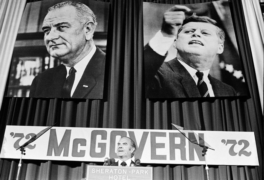 In this Aug. 9, 1972 file photo, with the pictures of former Democratic Presidents Kennedy and Johnson behind him, Sen. George McGovern, D-S.D., introduces Sargent Shriver as his new vice presidential running mate to the Democratic National Committee in Washington. A family spokesman says, McGovern, the Democrat who lost to President Richard Nixon in 1972 in a historic landslide, has died at the age of 90. According to a spokesman,  McGovern died Sunday, Oct. 21, 2012 at a hospice in Sioux Falls, surrounded by family and friends.  (AP Photo, File)