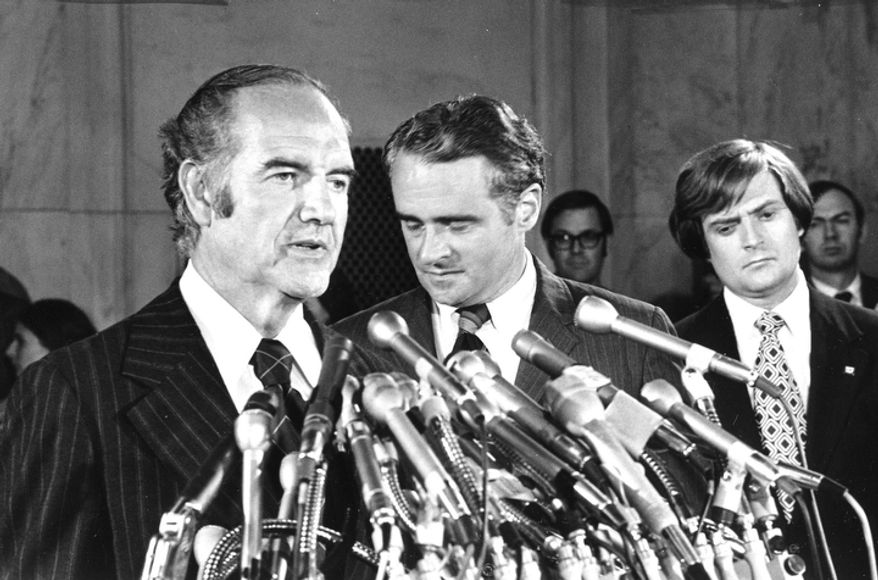 In this photo taken Aug. 1, 1972, Sen. Thomas Eagleton, center rear, has his head down as he listens to presidential hopeful Sen. George McGovern's announcement that Eagleton is stepping aside as vice-presidential running mate, at a Washington news conference. A family spokesman says, McGovern, the Democrat who lost to President Richard Nixon in 1972 in a historic landslide, has died at the age of 90. According to the spokesman,  McGovern died Sunday, Oct. 21, 2012 at a hospice in Sioux Falls, surrounded by family and friends. (AP Photo, File)