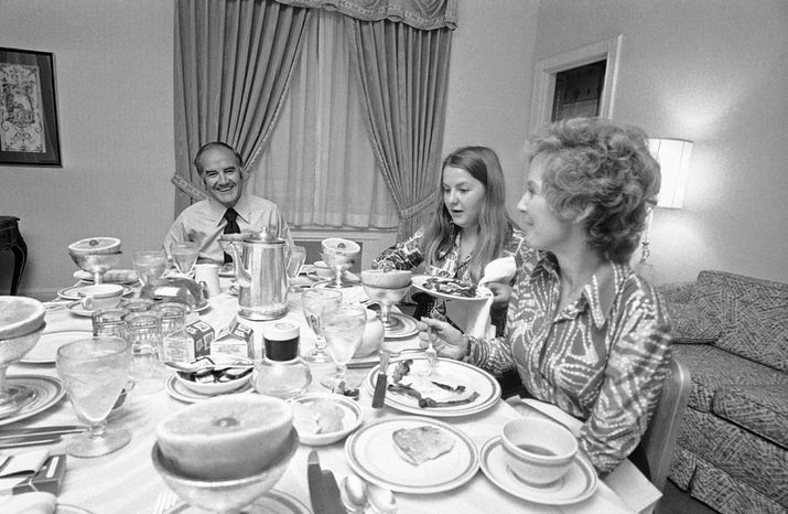 In this June 21, 1972 file photo, Sen. George McGovern, Democratic presidential candidate, has breakfast with his daughter Teresa, center, and his wife Eleanor at his hotel Biltmore headquarters in New York following primary victory in New York State.   A family spokesman says, McGovern, the Democrat who lost to President Richard Nixon in 1972 in a historic landslide, has died at the age of 90. According to the spokesman,  McGovern died Sunday, Oct. 21, 2012 at a hospice in Sioux Falls, surrounded by family and friends.  (AP Photo/Ray Stubblebine)