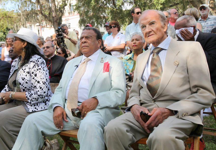 In this June 11, 2011 photo,  George McGovern, right, sits next to Andrew Young during the dedication of the Andrew Young Crossing monument in St. Augustine, Fla.  A family spokesman says, McGovern, the Democrat who lost to President Richard Nixon in 1972 in a historic landslide, has died at the age of 90. According to a spokesman,  McGovern died Sunday, Oct. 21, 2012 at a hospice in Sioux Falls, surrounded by family and friends. (AP Photo/The St. Augustine Record, Daron Dean)