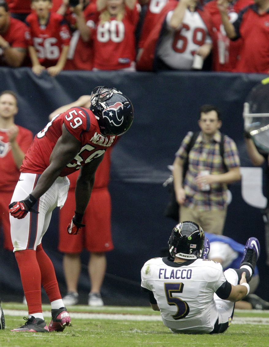Houston Texans linebacker Whitney Mercilus (59) celebrates after sacking Baltimore Ravens quarterback Joe Flacco (5) during the first quarter of an NFL football game on Sunday, Oct. 21, 2012, in Houston. (AP Photo/Patric Schneider)