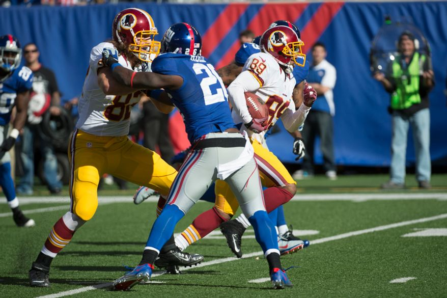 Washington Redskins wide receiver Santana Moss (89) breaks away for a touchdown against the New York Giants in the second quarter at MetLife Stadium in East Rutherford, N.J., on Sunday, Oct. 21, 2012. (Rod Lamkey Jr./The Washington Times)