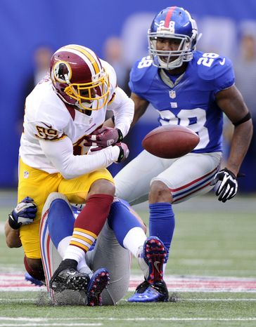 Washington Redskins wide receiver Santana Moss (89) fumbles the ball with under a minute left to play giving the Giants the ball and the victory at MetLife Stadium, East Rutherford, N.J., Oct. 21, 2012. (Preston Keres/Special to The Washington Times)