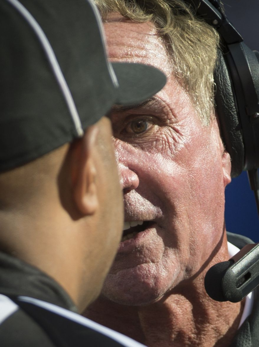 Washington Redskins Head Coach Mike Shanahan has words with Line Judge Adrian Hill in the fourth quarter at MetLife Stadium in East Rutherford, N.J., Sunday, Oct. 21, 2012. (Rod Lamkey Jr./The Washington Times)