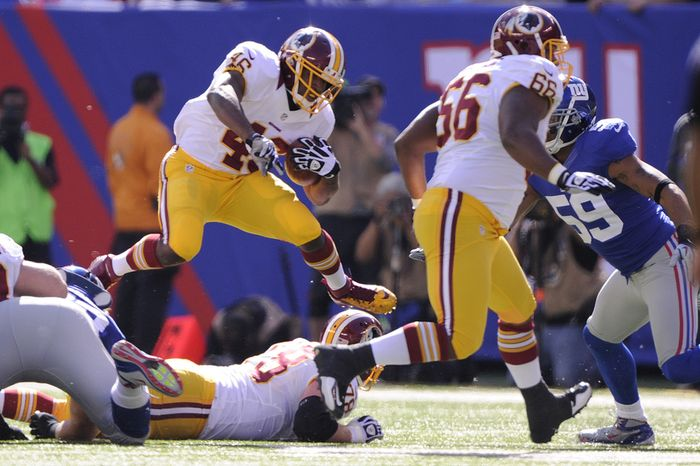 Washington Redskins running back Alfred Morris (46) leaps over the line during a first quarter carry against the Giants at MetLife Stadium, East Rutherford, N.J., Oct. 21, 2012. (Preston Keres/Special to The Washington Times)