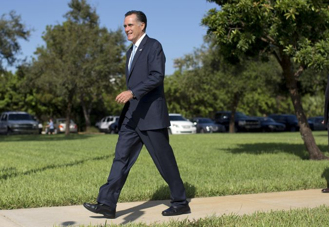 Republican presidential candidate Mitt Romney leaves the Church of Jesus Christ of Latter-day Saints after services on Sunday, Oct. 21, 2012, in Boca Raton, Fla. (AP Photo/Evan Vucci)