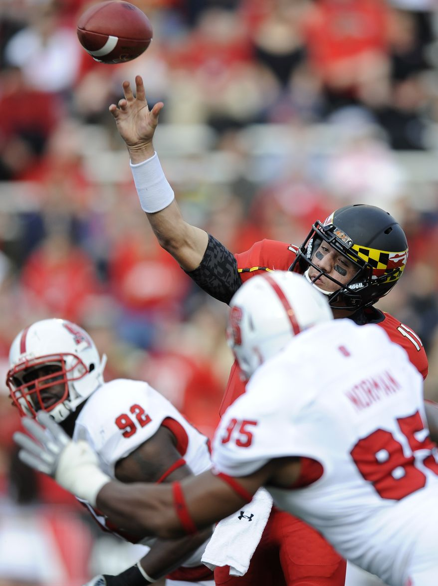 Maryland quarterback Perry Hills (11) throws a pass under pressure against North Carolina State defensive end Art Norman (95) and defensive end Darryl Cato-Bishop (92) during the first half of an NCAA football game, Saturday, Oct. 20, 2012, in College Park, Md. (AP Photo/Nick Wass)