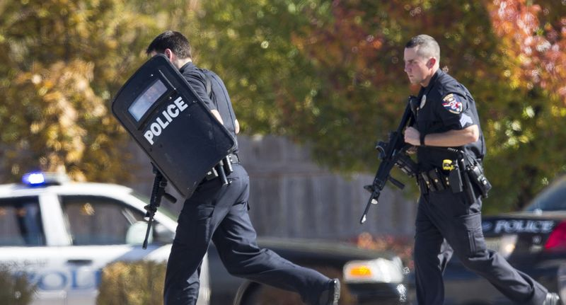 Police respond to a call of a shooting at the Azana Day Spa in Brookfield, Wis., a Milwaukee suburb, on Sunday, Oct. 21, 2012. (AP Photo/Tom Lynn)