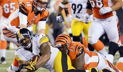 associated press These two lines to fill. These two lines to fill. These two lines to fill. These two lines to fill. These two lines to fill. These two lines to fill. These two lines to fill. These two.  Pittsburgh Steelers linebacker LaMarr Woodley (56) is tackled by Cincinnati Bengals tackle Andre Smith (71) after intercepting a pass from quarterback Andy Dalton (14) in the first half of an NFL football game, Sunday, Oct. 21, 2012, in Cincinnati. (AP Photo/Michael Keating)