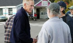 ** FILE ** Independent Angus King greets workers leaving Bath Iron Works in Bath, Maine, on Monday, Oct. 22, 2012. (Associated Press)