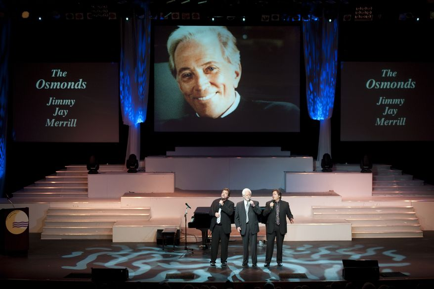 "Jay Osmond (from left), Merrill Osmond and Jimmy Osmond sing at a memorial tribute to singer Andy Williams at the Moon River Theatre in Branson, Mo., on Sunday, Oct. 21, 2012. Williams, known for his rendition of ""Moon River"" and his Christmas television specials, died Sept. 25. (AP Photo/Grant Hindsley)"
