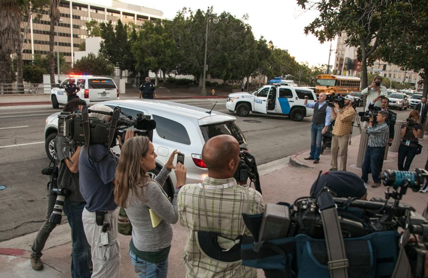 U.S. marshals block the street as agents drive away in a vehicle believed to be carrying Nakoula Basseley Nakoula after his arraignment in federal court in Los Angeles Thursday, Sept. 27, 2012. A federal judge on Thursday ordered Nakoula, the man behind a crudely produced anti-Islamic video that inflamed parts of the Middle East to be detained because he is a flight risk and violated terms of his probation. (AP Photo/Damian Dovarganes)