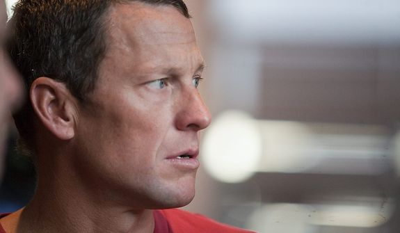 U.S. cyclist Lance Armstrong is interviewed in Austin, Texas, on Friday, Feb. 15, 2011. UCI, the cycling governing body, agreed on Monday, Oct. 22, 2012, to strip Armstrong of his seven Tour de France titles. (AP Photo/Thao Nguyen)