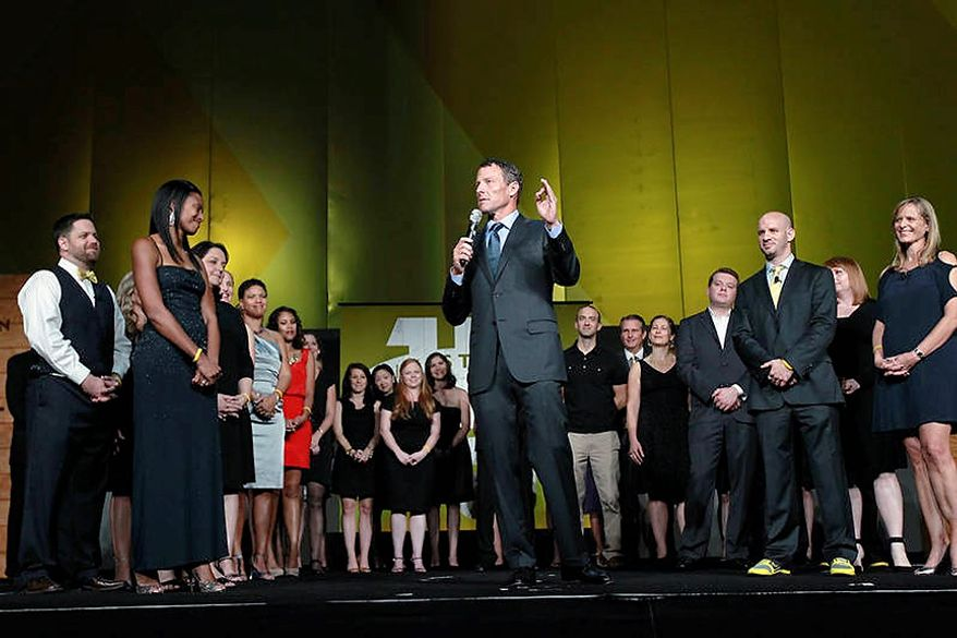 "Cyclist Lance Armstrong stands onstage during the 15th anniversary celebration for Livestrong, his cancer-fighting charity, on Friday, Oct. 19, 2012, in Austin, Texas. Joining him are members of Livestrong's staff, many of whom are cancer survivors. Armstrong said he has been through a ""difficult couple of weeks"" and urged supporters of the charity to stand behind its mission. ""The mission is bigger than me. It's bigger than any individual,"" Armstrong said in opening remarks at the celebration. (AP Photo/Livestrong, Elizabeth Kreutz)"