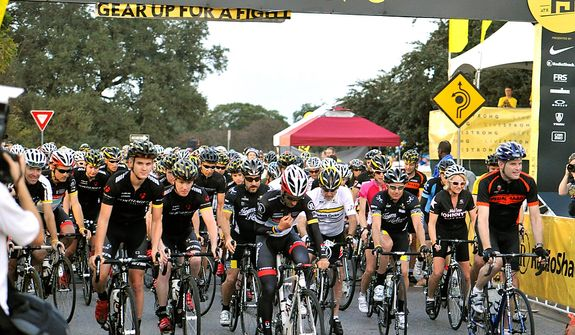 Bike riders begin their 100-mile ride in the Livestrong Challenge Austin charity event on Sunday, Oct. 21, 2012, in Austin, Texas. Cyclist Lance Armstrong greeted about 4,300 cyclists at his charity's fundraiser and then retreated into privacy as cycling officials got set to announce if they will appeal his lifetime ban and loss of seven Tour de France titles ordered by the U.S. Anti-Doping Agency. (AP Photo/Michael Thomas)
