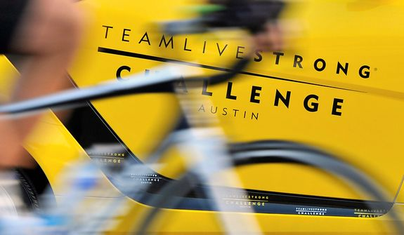A cyclist starts off on his 100-miles ride at the Livestrong Challenge Austin charity event on Sunday, Oct. 21, 2012, in Austin, Texas. Lance Armstrong greeted about 4,300 cyclists at his Livestrong charity's fundraiser and then retreated into privacy as cycling officials got set to announce if they will appeal his lifetime ban and loss of seven Tour de France titles ordered by the U.S. Anti-Doping Agency. (AP Photo/Michael Thomas)