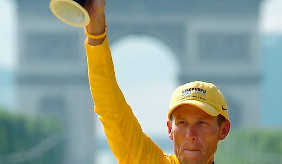 Cyclist Lance Armstrong holds the winner's trophy after claiming his seventh straight Tour de France race during ceremonies on the Champs-Elysees in Paris on July 24, 2005, after the 21st and final stage of the race between Corbeil-Essonnes, south of Paris, and the French capital. UCI, the cycling governing body, agreed on Monday, Oct. 22, 2012, to strip Armstrong of his seven Tour de France titles. (AP Photo/Bernard Papon, Pool)