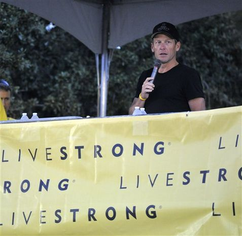 Lance Armstrong speaks at the Livestrong Challenge Austin bike ride Sunday, Oct. 21, 2012, in Austin, Texas. (AP Photo/Michael Thomas)
