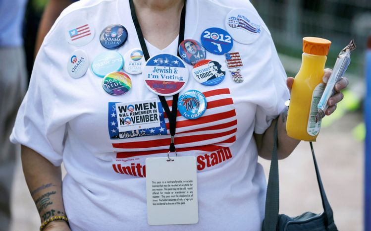 Doris Smith, of Boynton Beach, Fla., wears buttons on her shirt before the presidential debate. (AP Photo/Charlie Neibergall)