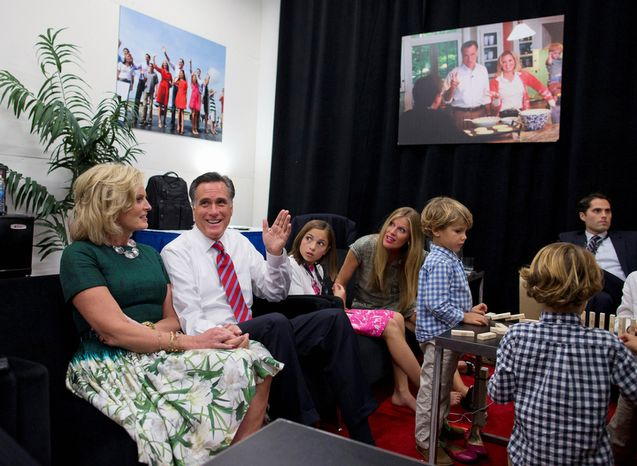 Republican presidential candidate, former Massachusetts Gov. Mitt Romney, second from left, and his wife Ann, left, sits in a holding room with his family before he participates in the third presidential debate with President Barack Obama.  (AP Photo/ Evan Vucci)