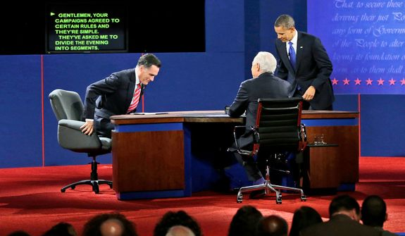Moderator Bob Schieffer, center, watches as Republican presidential candidate, former Massachusetts Gov. Mitt Romney and President Barack Obama take their seats before the start of the last debate. (AP Photo/Pablo Martinez Monsivais)