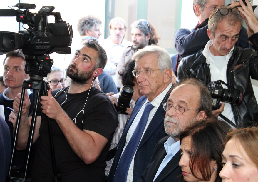 Defendants Claudio Eva (center) and Bernardo De Bernardinis (third from right) listen to the verdict at the court in L'Aquila, Italy, on Monday, Oct. 22, 2012. The two were among seven scientists and experts convicted of manslaughter for failing to adequately warn citizens before an earthquake struck central Italy in 2009, killing more than 300 people. (AP Photo/Raniero Pizzi)