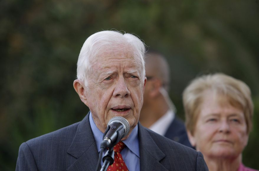 ** FILE ** Former President Jimmy Carter speaks Oct. 22, 2012, in the West Bank city of Ramallah to the media following a meeting with Palestinian President Mahmoud Abbas. (Associated Press)