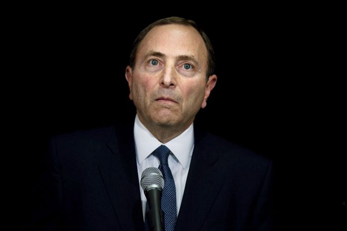 """NHL Commissioner Gary Bettman faces journalists following collective bargaining talks in Toronto, Thursday, Oct. 18, 2012. Bettman received three counterproposals from the players' association on Thursday and left the negotiating table """"thoroughly disappointed,"""" further shrinking the possibility of a full hockey regular season. (AP Photo/The Canadian Press, Chris Young)"""
