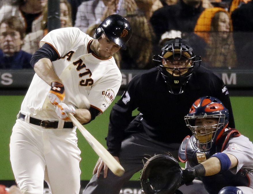 San Francisco Giants' Brandon Belt hits a home run during the eighth inning of Game 7 of baseball's National League championship series against the St. Louis Cardinals Monday, Oct. 22, 2012, in San Francisco. (AP Photo/Mark Humphrey)