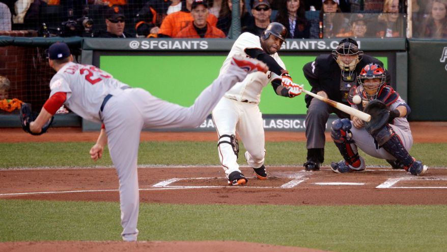 San Francisco Giants 3B Pablo Sandoval hits a double off St. Louis Cardinals starting pitcher Chris Carpenter in the first inning of Game 6 of the National League Championship Series on Oct. 21, 2012, in San Francisco. The Giants won 6-1 to force a decisive Game 7. (Associated Press)