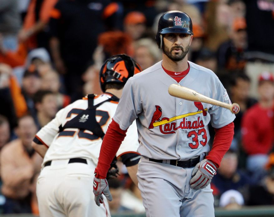 St. Louis Cardinals 2B Daniel Descalso (33) flips his bat in front of San Francisco Giants catcher Buster Posey after striking out in the second inning of Game 6 of the National League Championship Series on Oct. 21, 2012, in San Francisco. The Giants won 6-1 to force a decisive Game 7. (Associated Press)
