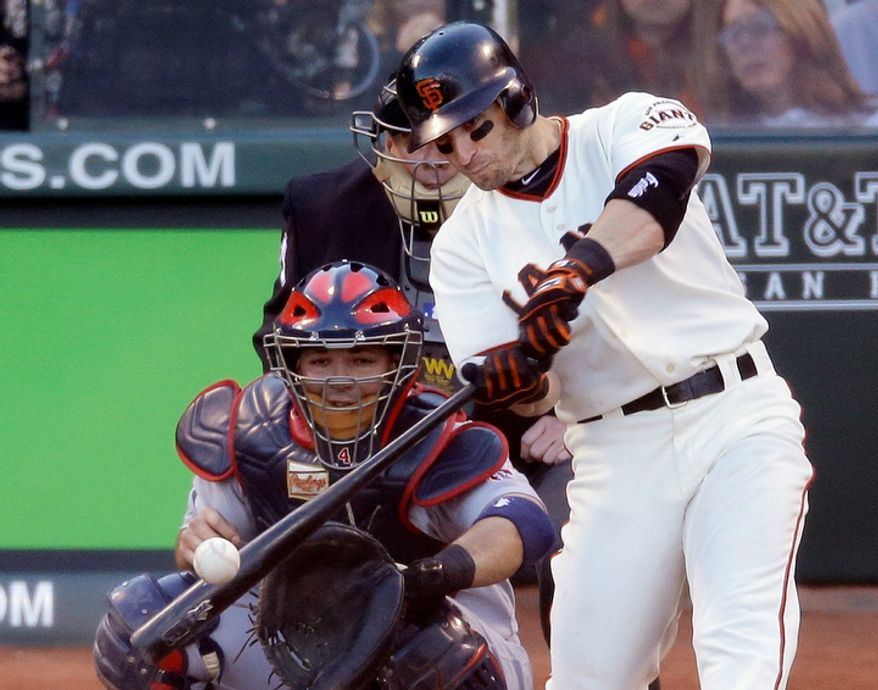 San Francisco Giants 2B Marco Scutaro hits a two-run double against the St. Louis Cardinals in the second inning of Game 6 of the National League Championship Series on Oct. 21, 2012, in San Francisco. The Giants won 6-1 to force a decisive Game 7. (Associated Press)