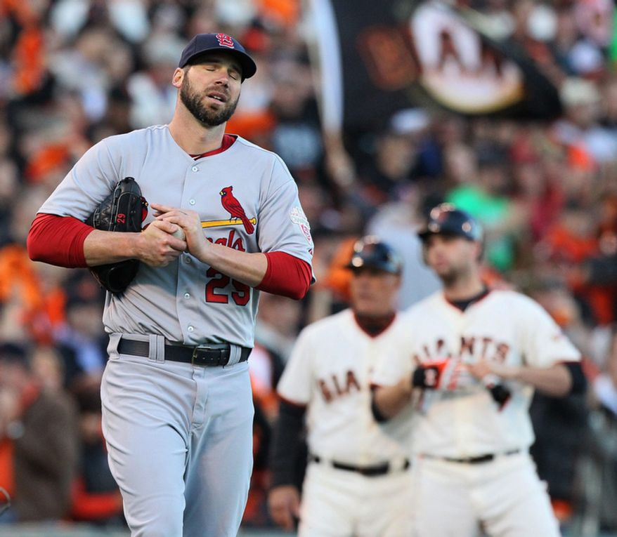 St. Louis Cardinals starting pitcher Chris Carpenter (left) reacts after allowing a lead-off triple to San Francisco Giants 1B Brandon Belt (right) in the second inning Game 6 of the National League Championship Series on Oct. 21, 2012, in San Francisco. The Giants won 6-1 to force a decisive Game 7. (Associated Press/St. Louis Post-Dispatch)