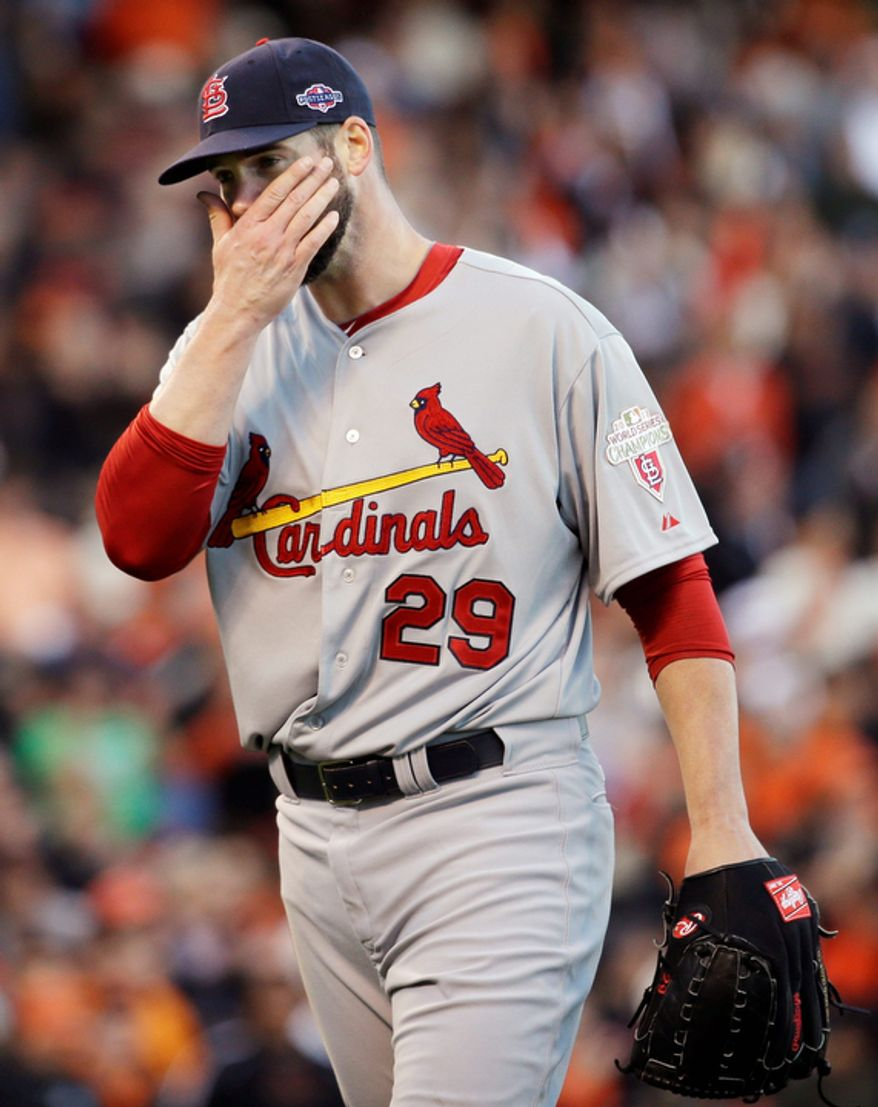 St. Louis Cardinals starting pitcher Chris Carpenter reacts as he walks to the dugout during the second inning of Game 6 of the National League Championship Series against the San Francisco Giants on Oct. 21, 2012, in San Francisco. The Giants won 6-1 to force a decisive Game 7. (Associated Press)