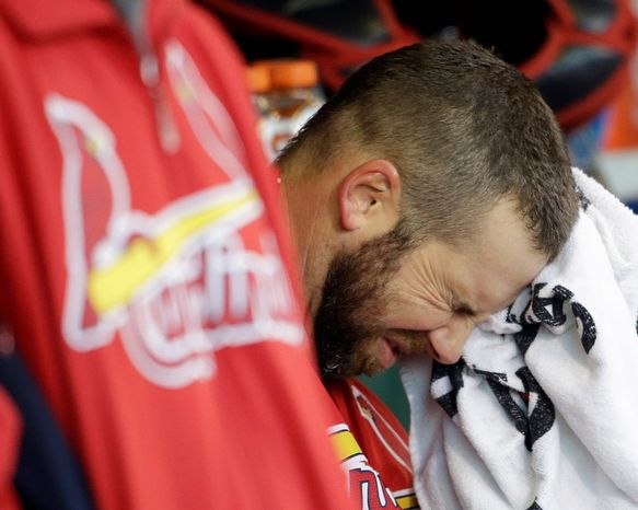 St. Louis Cardinals starting pitcher Chris Carpenter reacts in the dugout during the fourth inning of Game 6 of the National League Championship Series against the San Francisco Giants on Oct. 21, 2012, in San Francisco. The Giants won 6-1 to force a decisive Game 7. (Associated Press)
