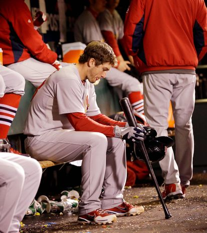St. Louis Cardinals 3B David Freese waits to bat during the eighth inning of Game 6 of the National League Championship Series against the San Francisco Giants on Oct. 21, 2012, in San Francisco. The Giants won 6-1 to force a decisive Game 7. (Associated Press)
