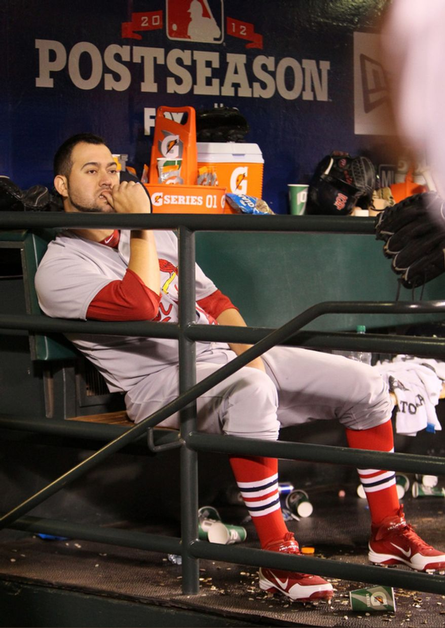 St. Louis Cardinals pitcher Edward Mujica sits in the dugout in the ninth inning during Game 6 of the National League Championship Series against the San Francisco Giants on Oct. 21, 2012, in San Francisco. The Giants won 6-1 to force a decisive Game 7. (Associated Press/St. Louis Post-Dispatch)