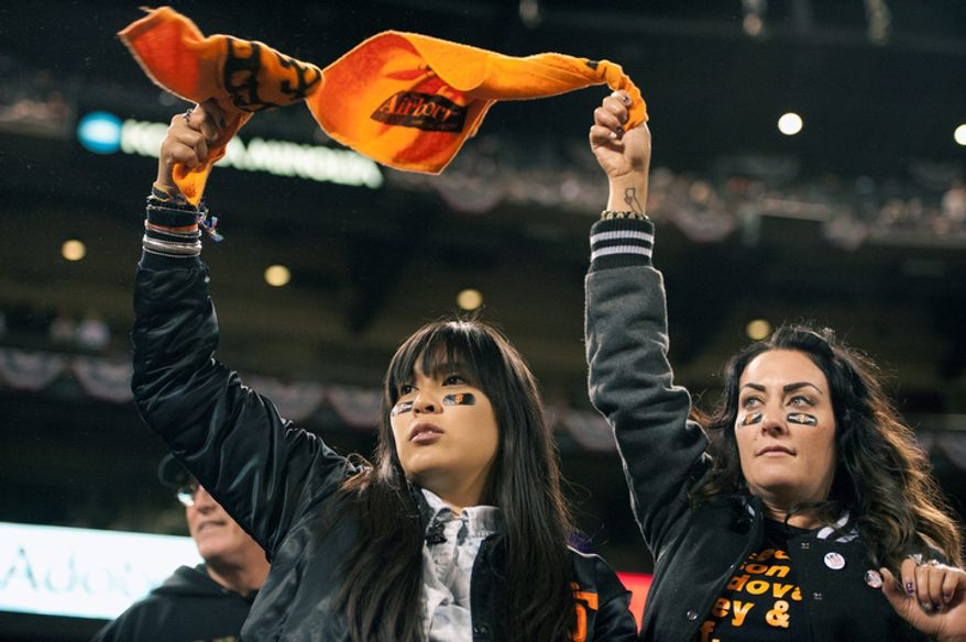 San Francisco Giants fans wave rally towels during Game 6 of the National League Championship Series on Oct. 21, 2012, in San Francisco. The Giants won 6-1 to force a decisive Game 7. (Associated Press/The Sacramento Bee)